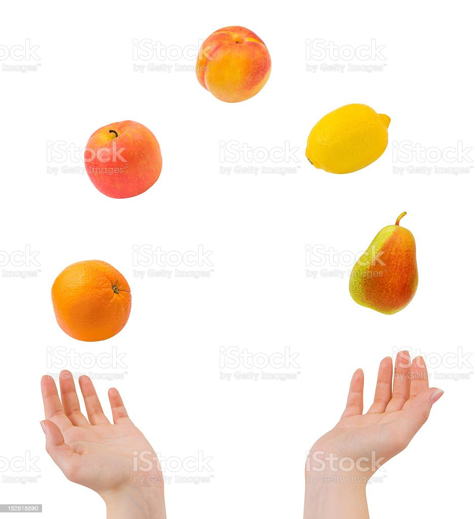 Juggling hands and fruits royalty-free stock photo