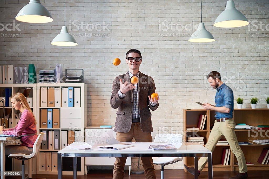 Juggling oranges stock photo