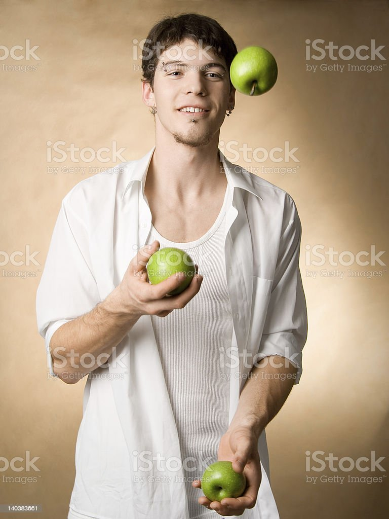 Juggling with apples royalty-free stock photo