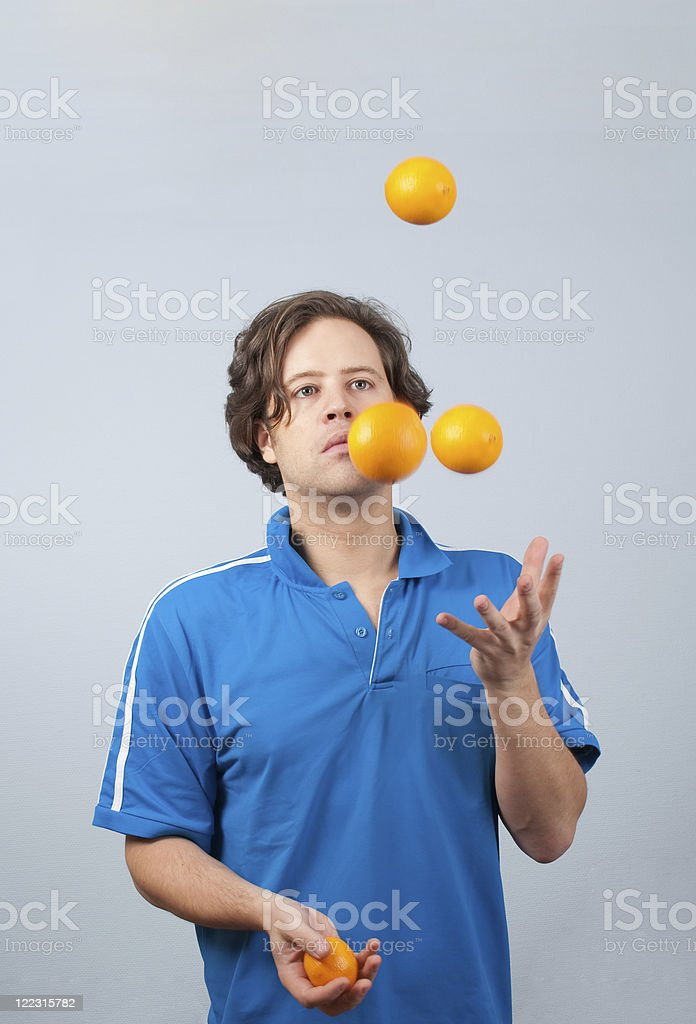Juggling with oranges royalty-free stock photo
