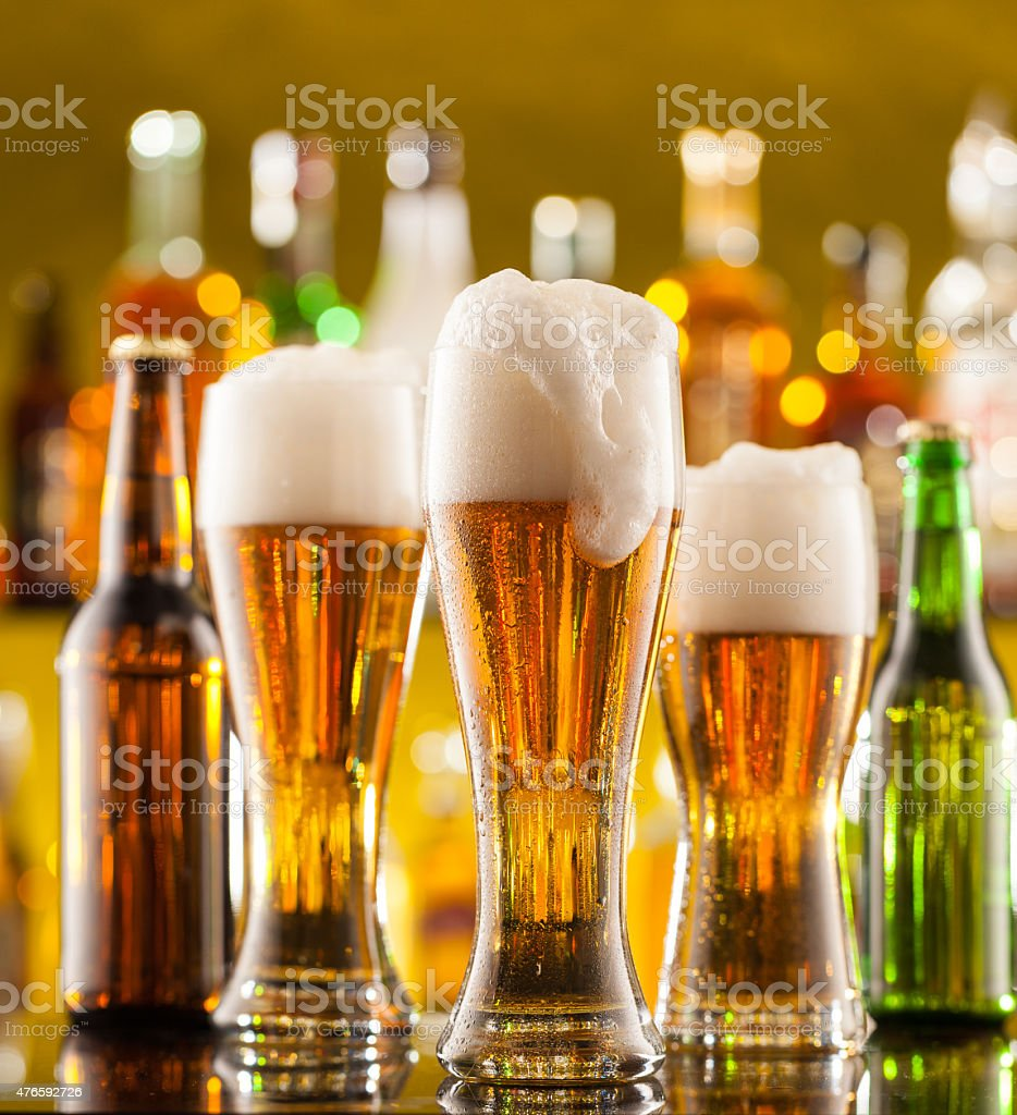 Jugs of beer served on bar counter stock photo