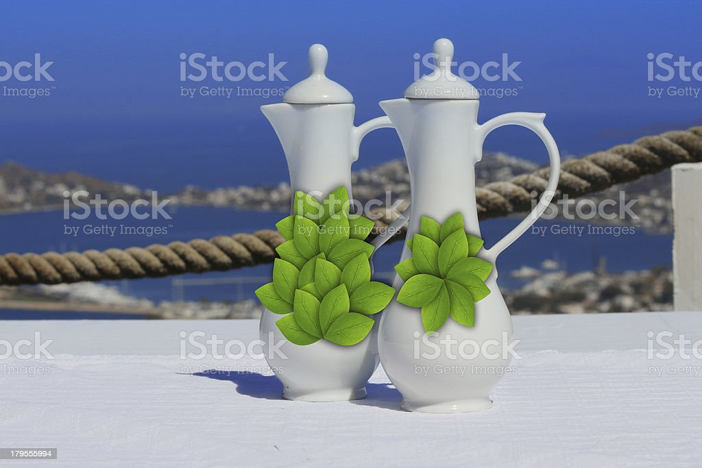 jugs olive oil and wine vinegarstand on mediterranean table royalty-free stock photo