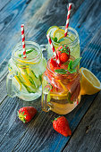 Jugs with lemon, lime, strawberry and cucumber infused water