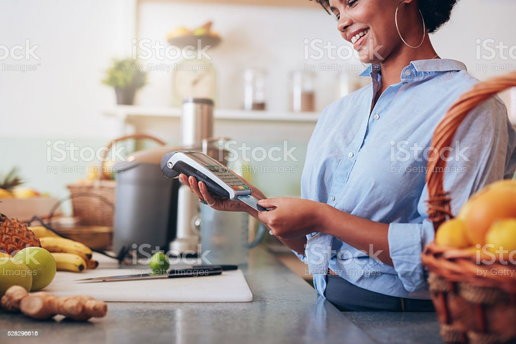 Juice bar credit card payment. stock photo