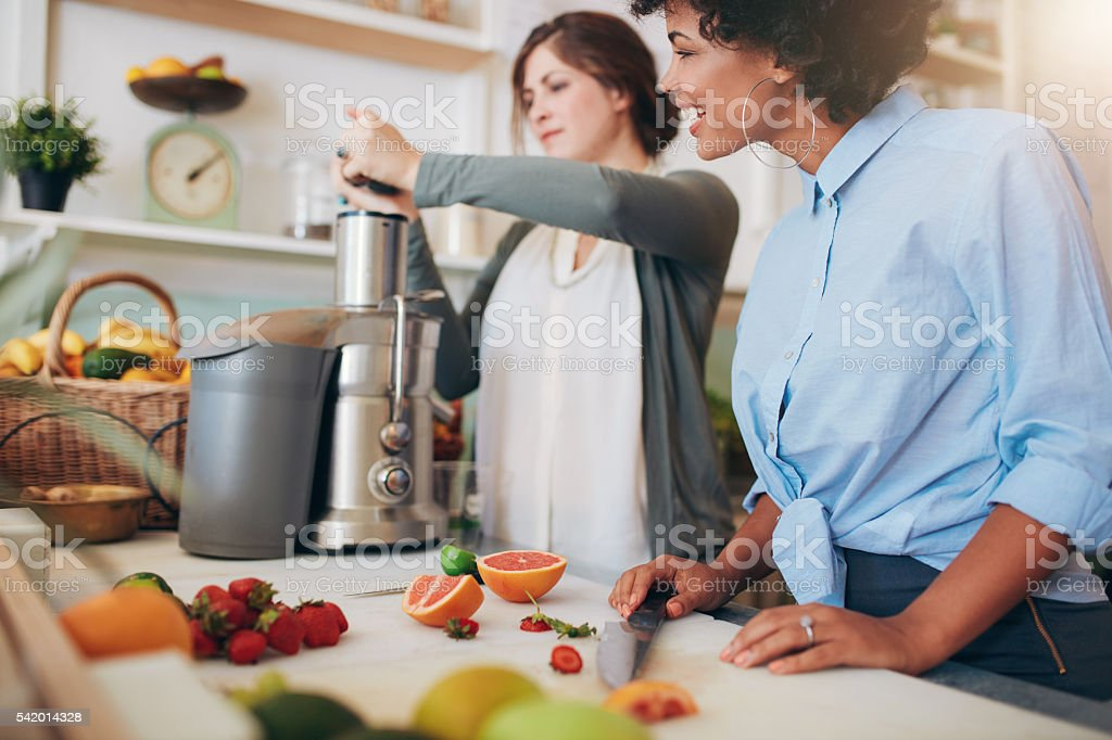 Juice bar employees preparing fresh fruit juices stock photo