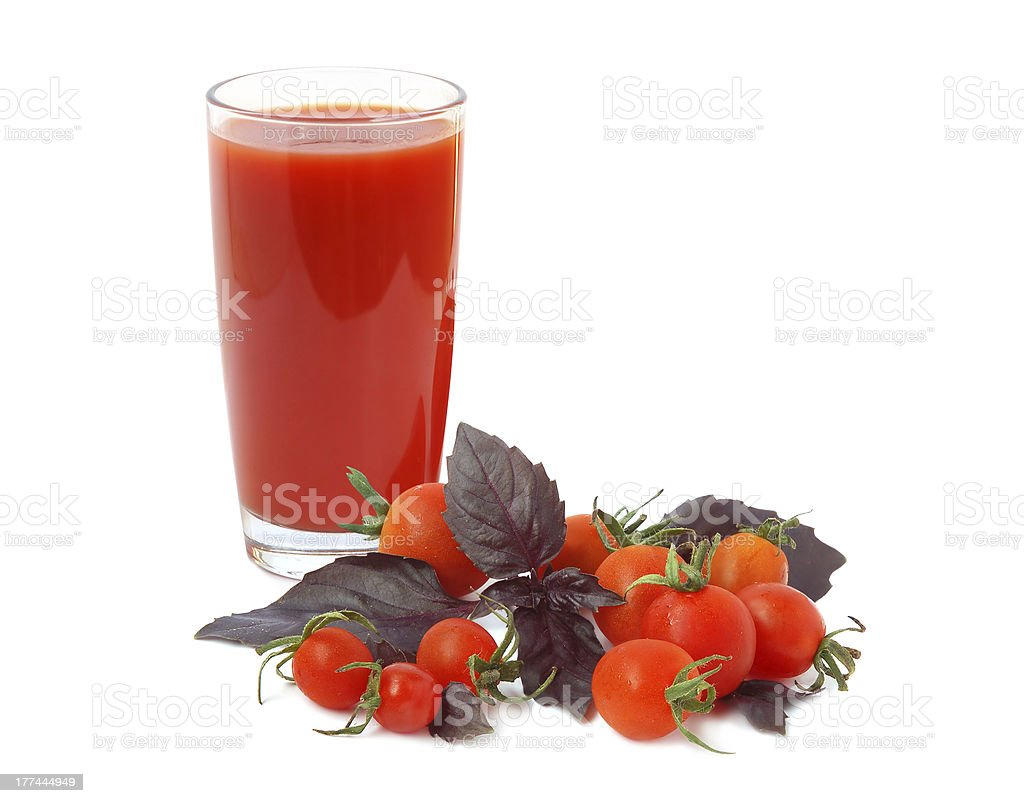 Juice, basil and cherry tomatoes royalty-free stock photo