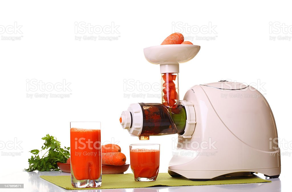 Juice extractor and carrot stock photo