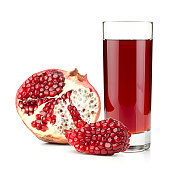 Juice in glass and ripe pomegranate