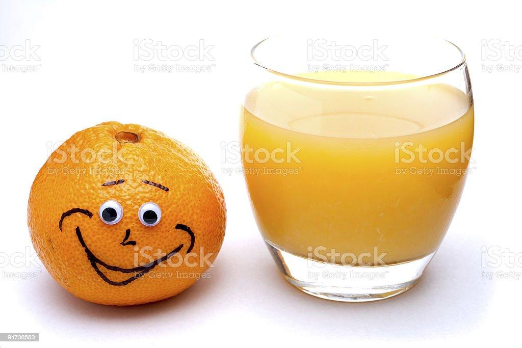 Juice next to a Happy Orange royalty-free stock photo