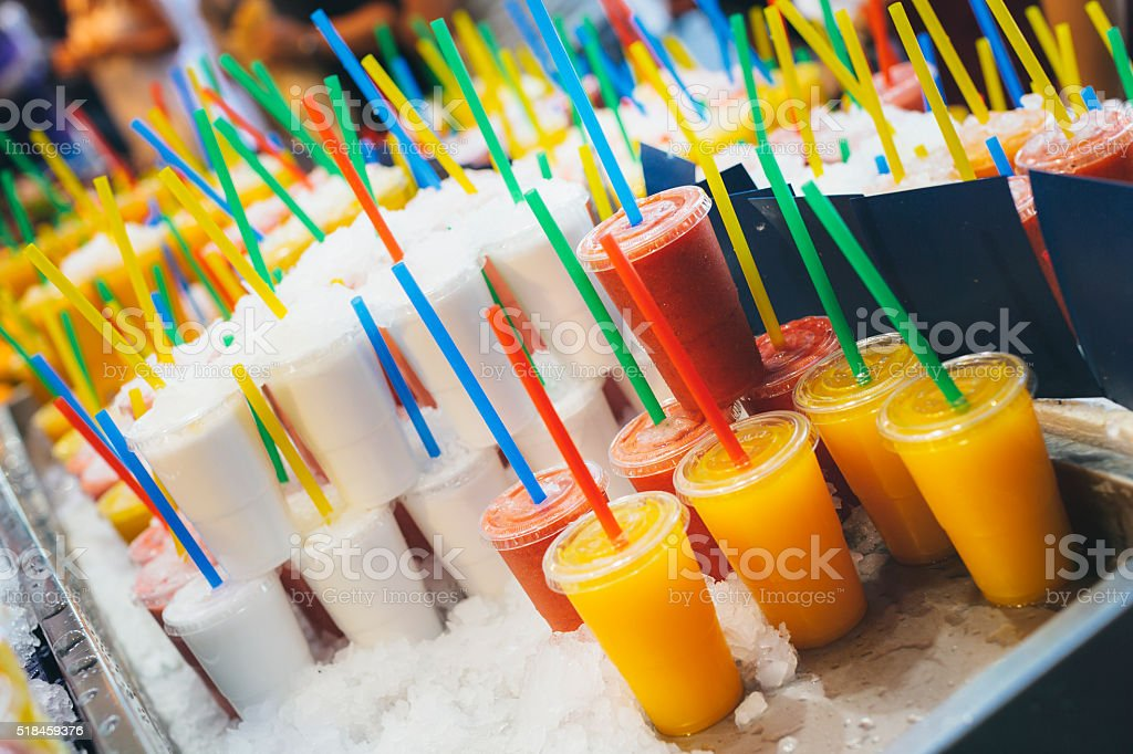 Juice, slush, water ice and fruits for a hot summer stock photo