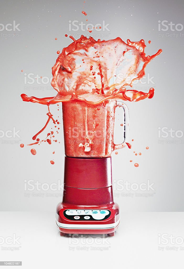 Juice splashing from blender stock photo