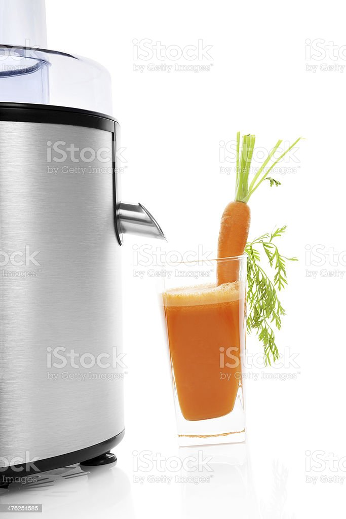 Juicer and fresh carrot juice isolated. royalty-free stock photo