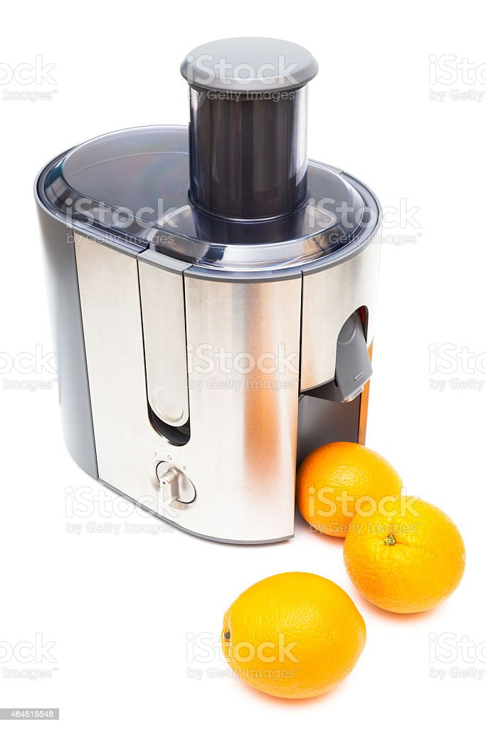 Juicer and oranges stock photo