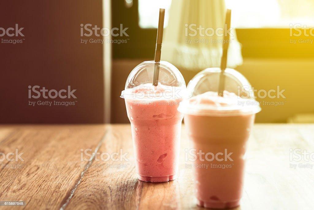 Juices in plastic glasses stock photo
