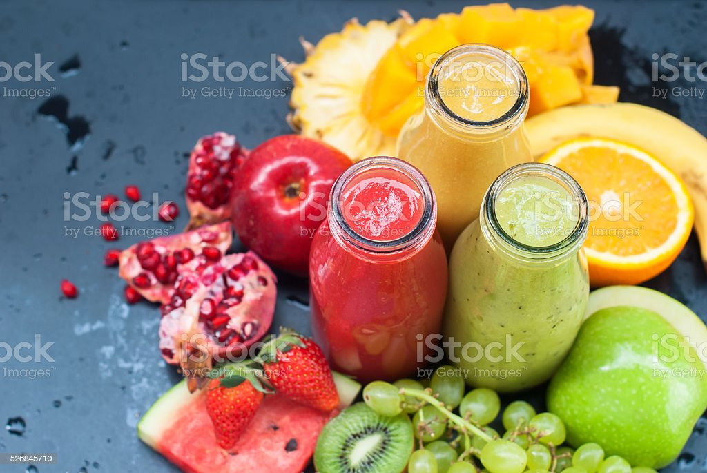 Juices Smoothie Red Green Orange Tropical Fruit stock photo