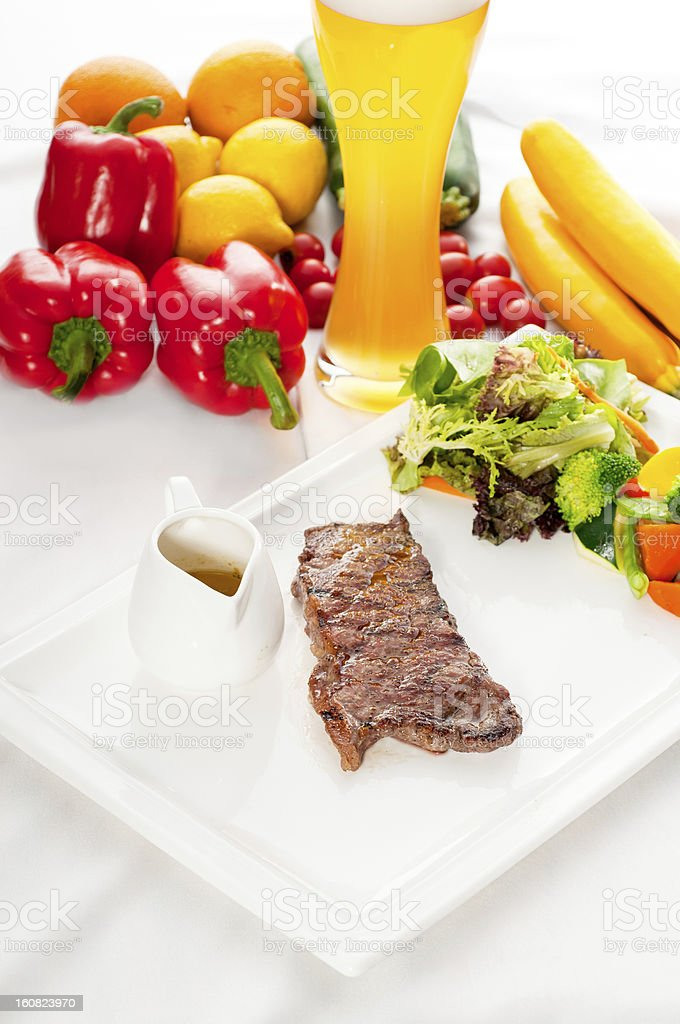 juicy BBQ grilled rib eye ,ribeye steak and vegetables royalty-free stock photo