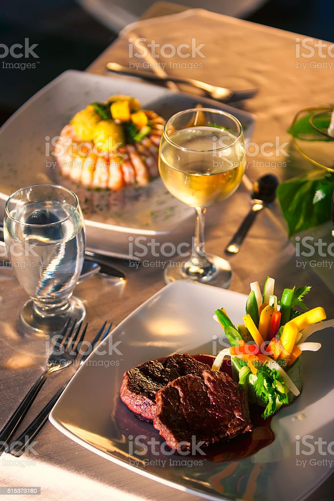Juicy beef and wine glasses. stock photo