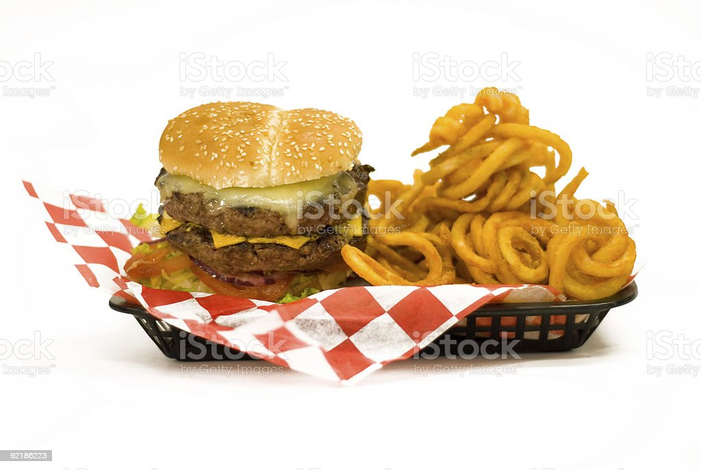 Juicy Burger with curly fries stock photo