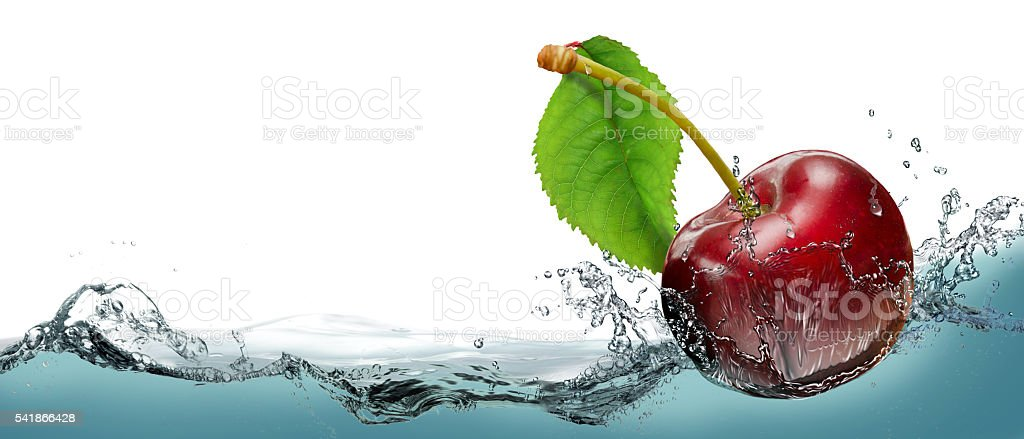 Juicy cherry berry in a spray of cool water. stock photo