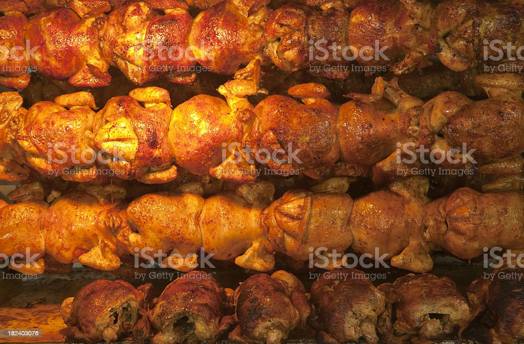 Juicy Chickens Roasting on Rotisserie, Poultry, Food Background royalty-free stock photo