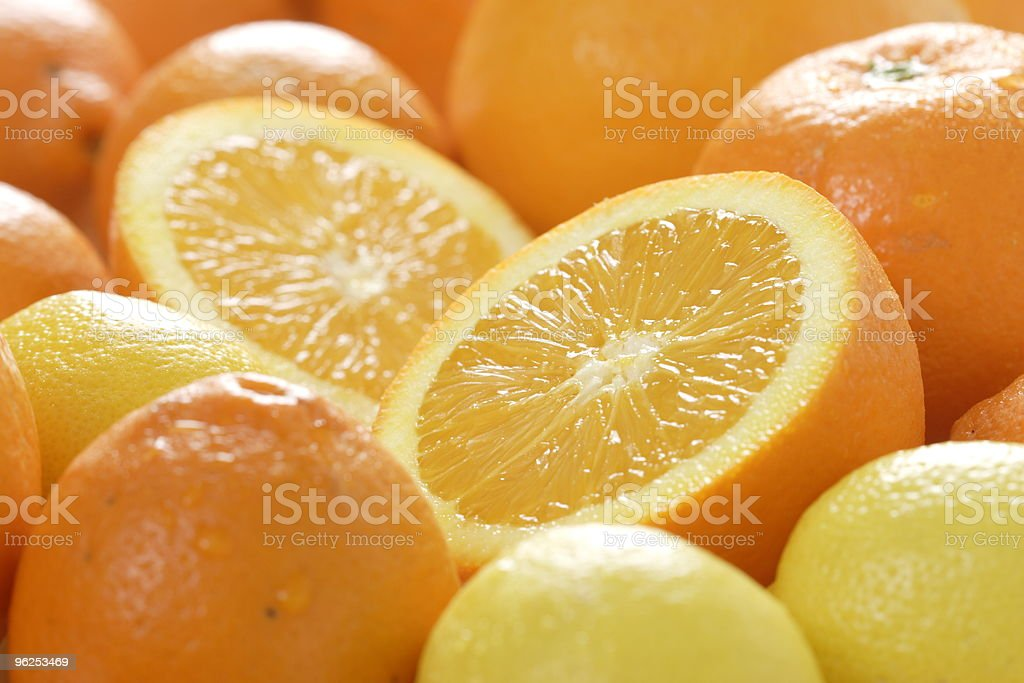 Juicy delicious oranges and citrons royalty-free stock photo