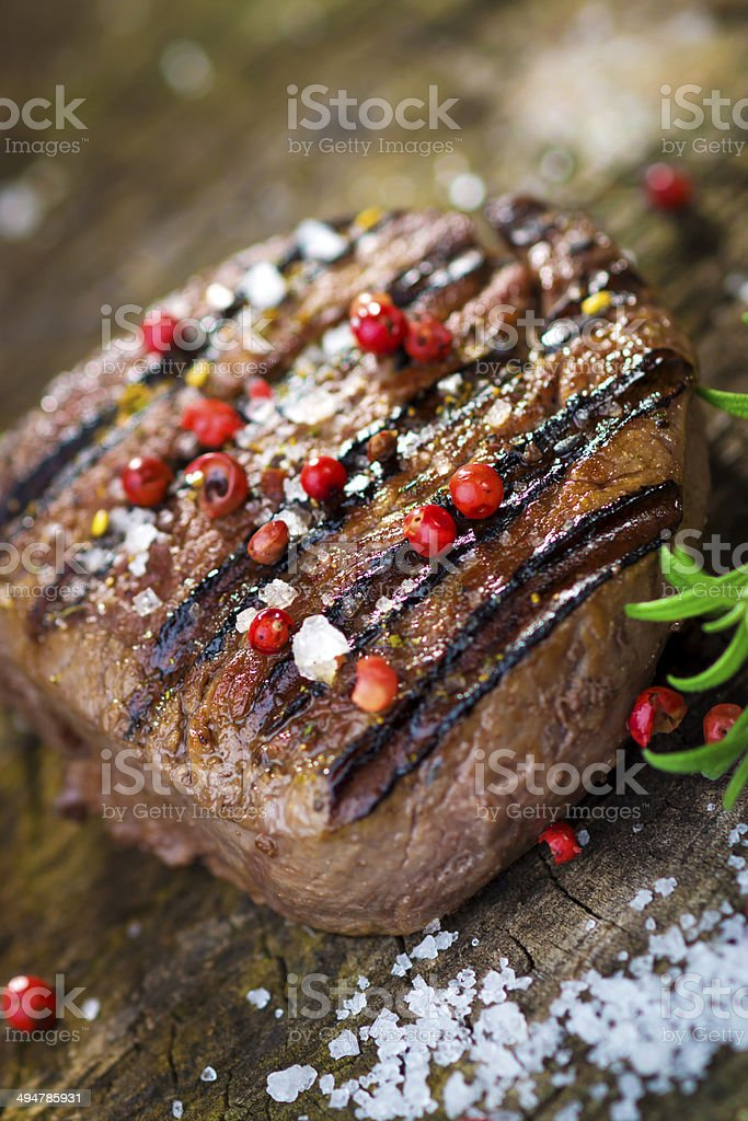 Juicy Fillet Steak with Fresh Herbs stock photo