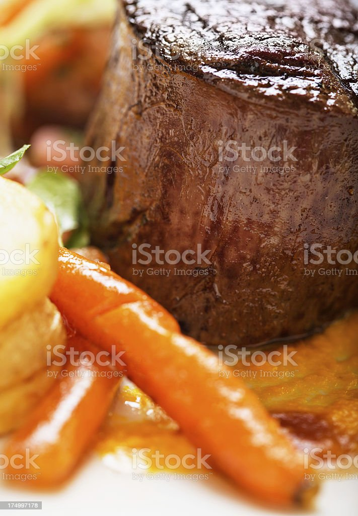Juicy fillet steak with glazed carrots and potatoes royalty-free stock photo