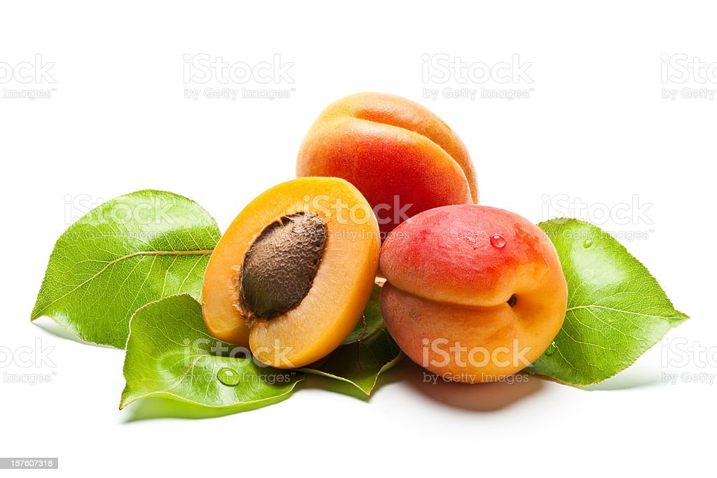 Juicy fresh apricots with leaves stock photo