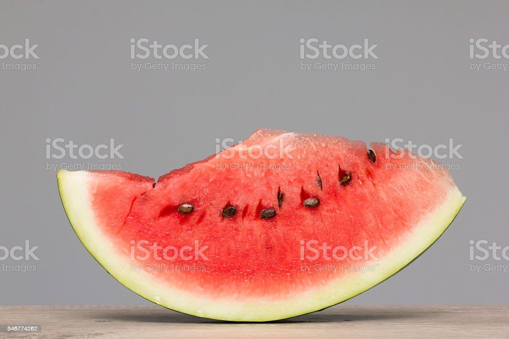 Juicy, fresh watermelon slice on wooden textured table stock photo