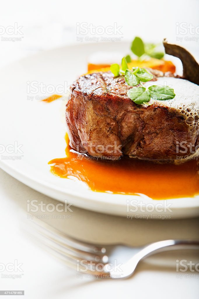 Juicy grilled fillet steak resting in pool of meat juice stock photo