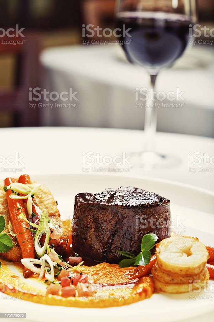Juicy grilled fillet steak with glazed vegetables and red wine stock photo