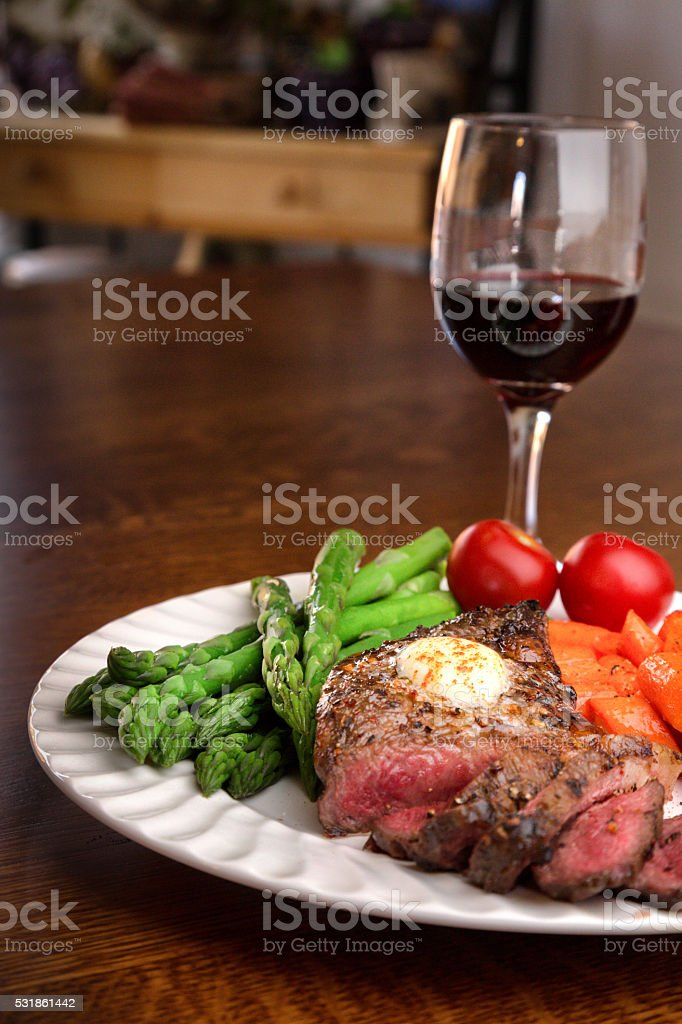 Juicy Grilled Ribeye Steak With Vegetables And Wine stock photo