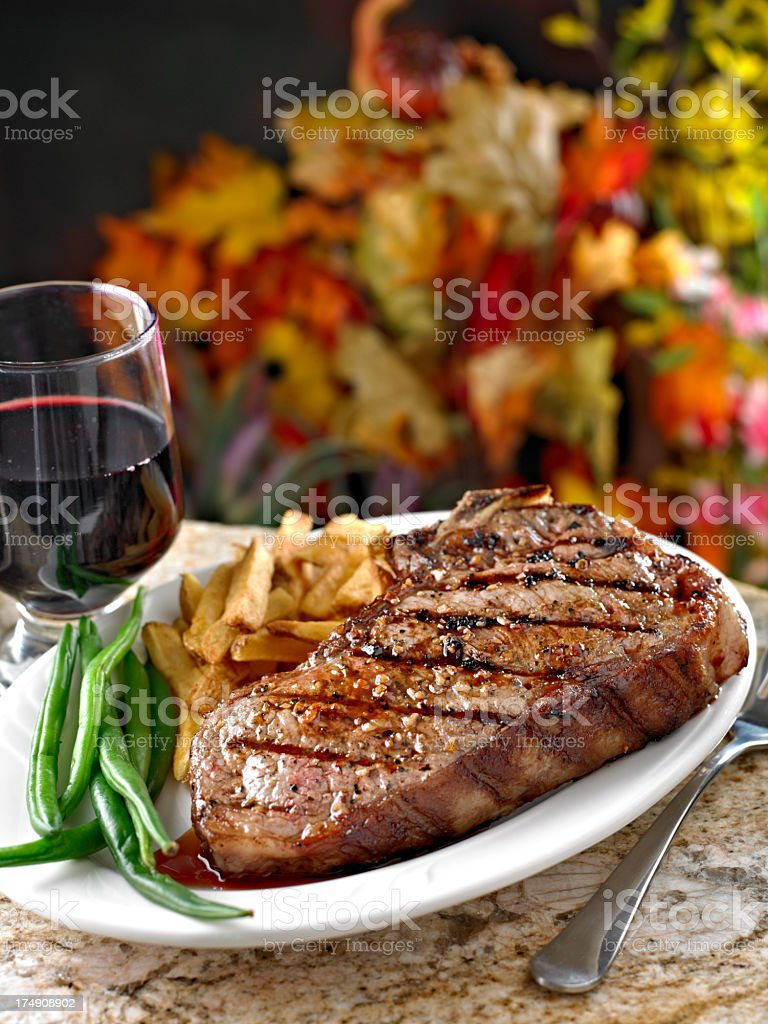 Juicy Grilled Steak with French Fries. royalty-free stock photo