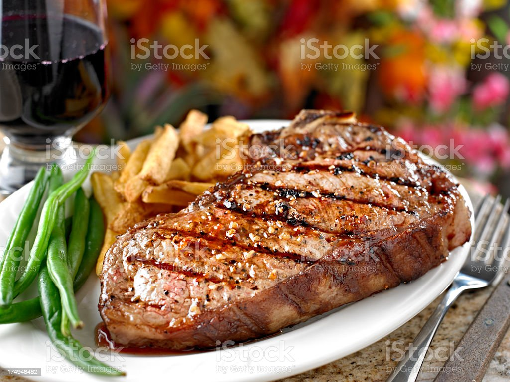 Juicy Grilled Steak with French Fries. stock photo