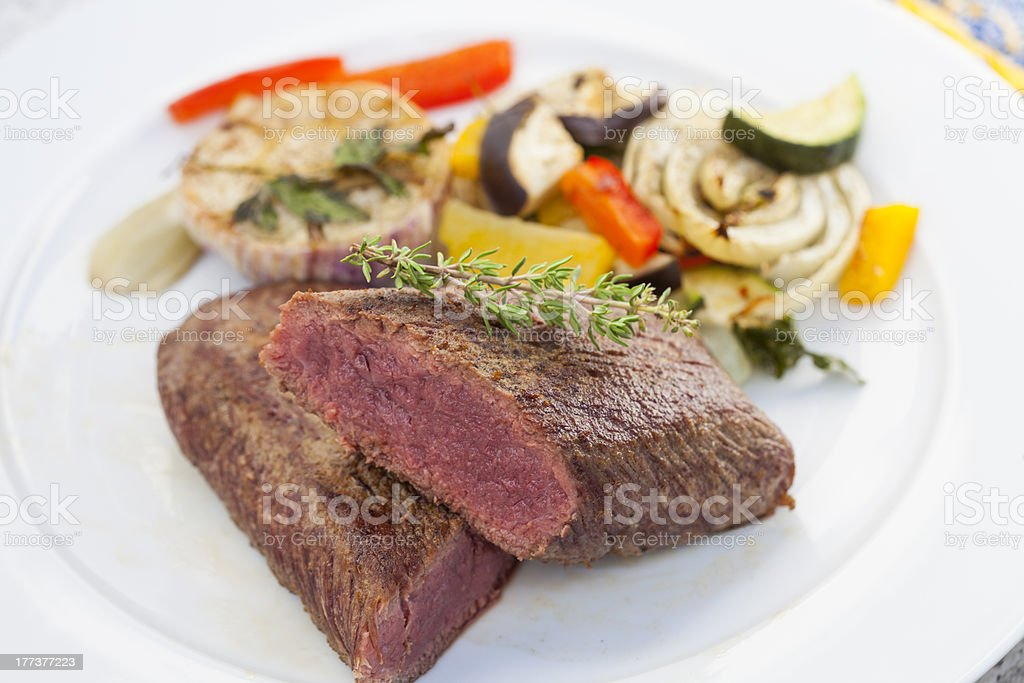 Juicy lamb loin with summer vegetables royalty-free stock photo