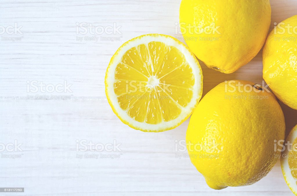 Juicy lemons on a white background. stock photo