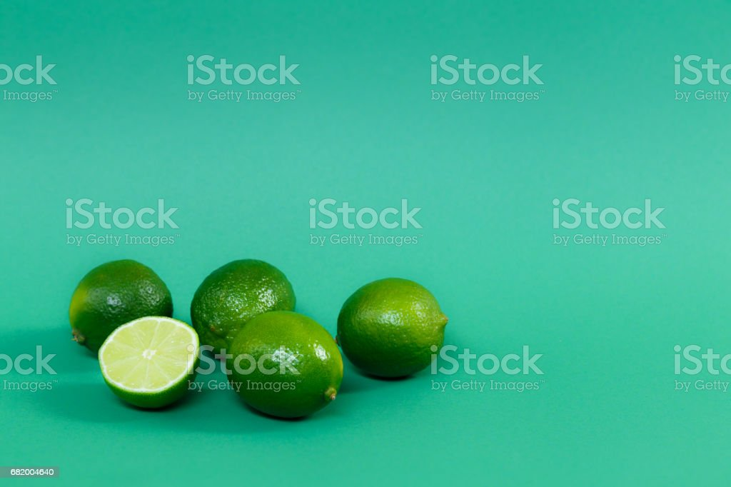 Juicy limes on a green background stock photo