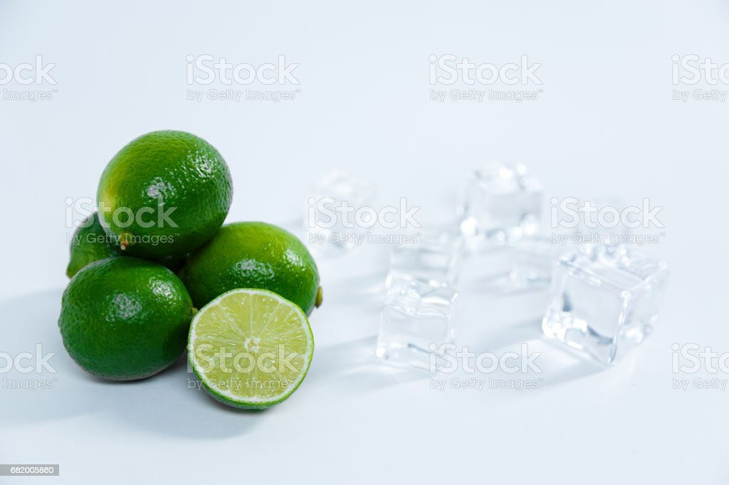 Juicy limes on a white background stock photo