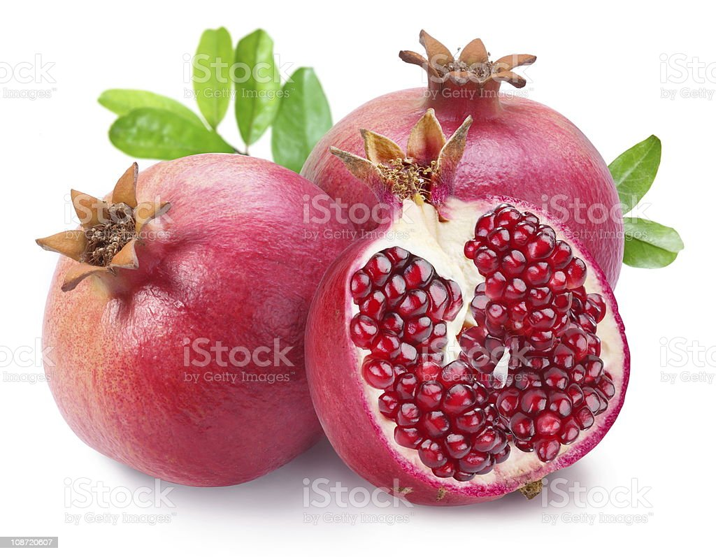 Juicy opened pomegranate with leaves. stock photo