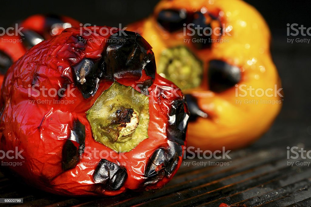 Juicy peppers being grilled stock photo