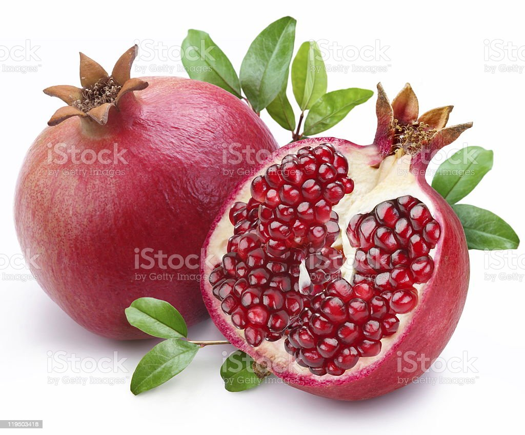 Juicy pomegranate and its half with leaves. stock photo