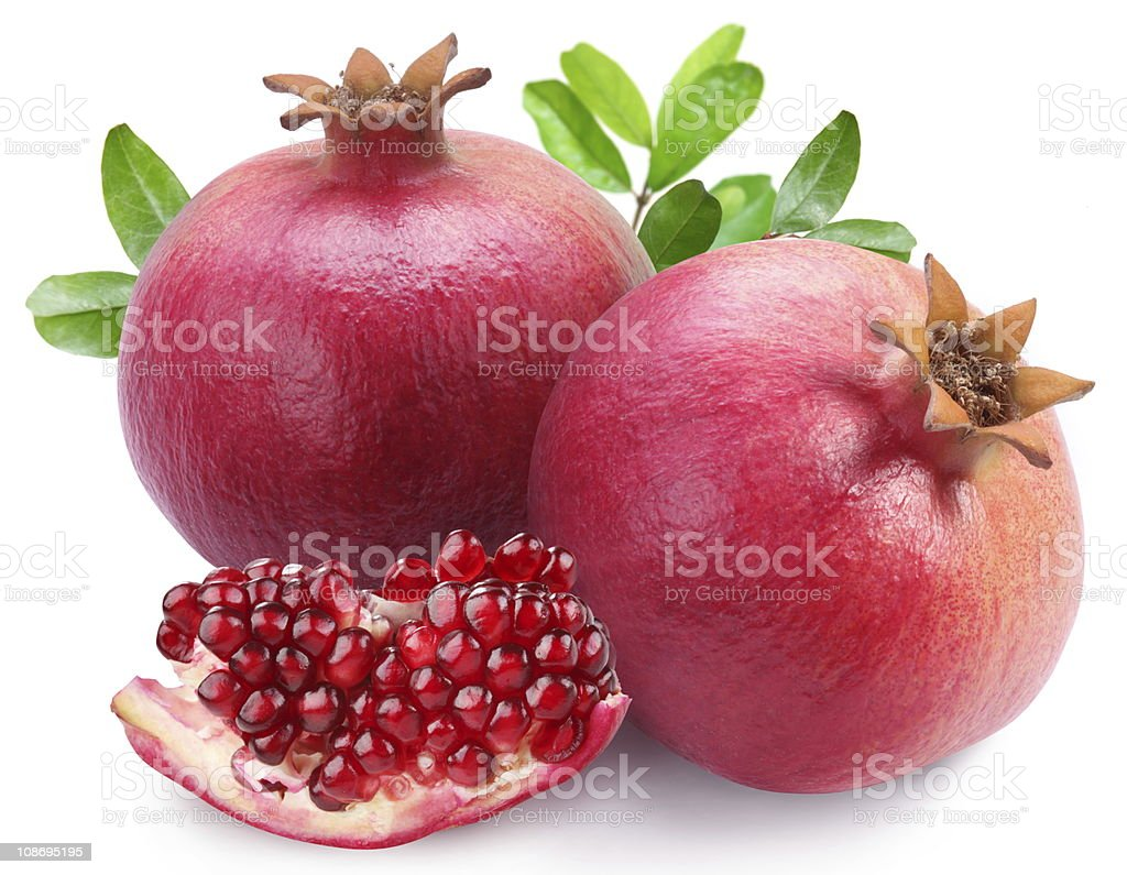 Juicy pomegranates and its section. stock photo
