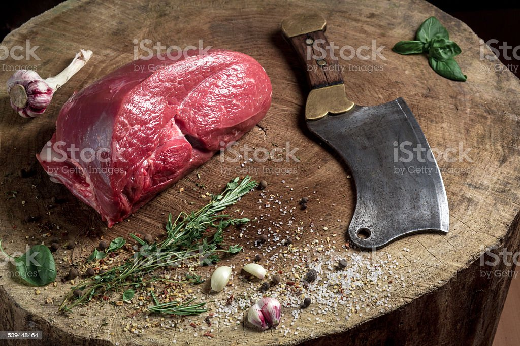 Juicy raw beef steak on wooden table stock photo