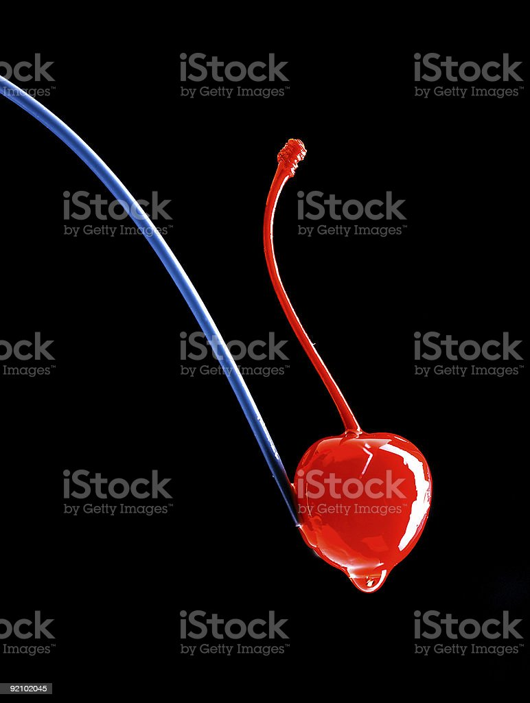 Juicy red cherry and straw  in black background. royalty-free stock photo