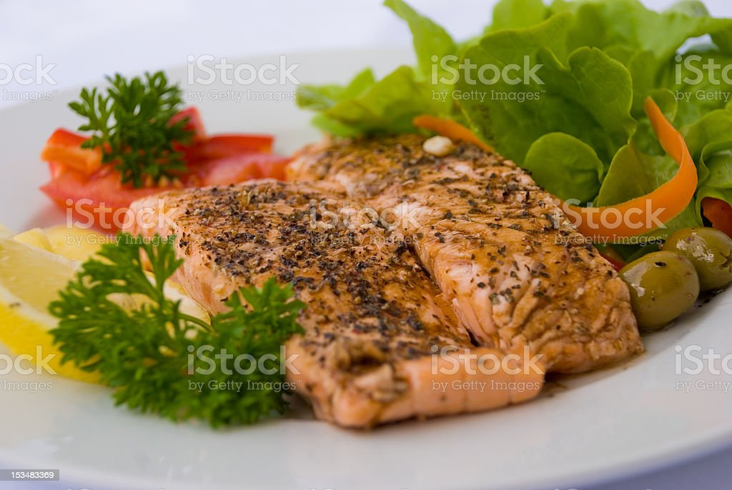 Juicy Salmon with Herbs-Sauce and Salad  - 2- stock photo