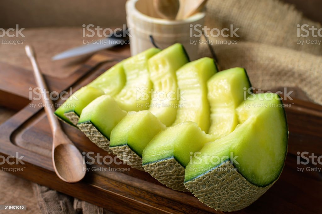 Juicy slice melon on a wooden table stock photo