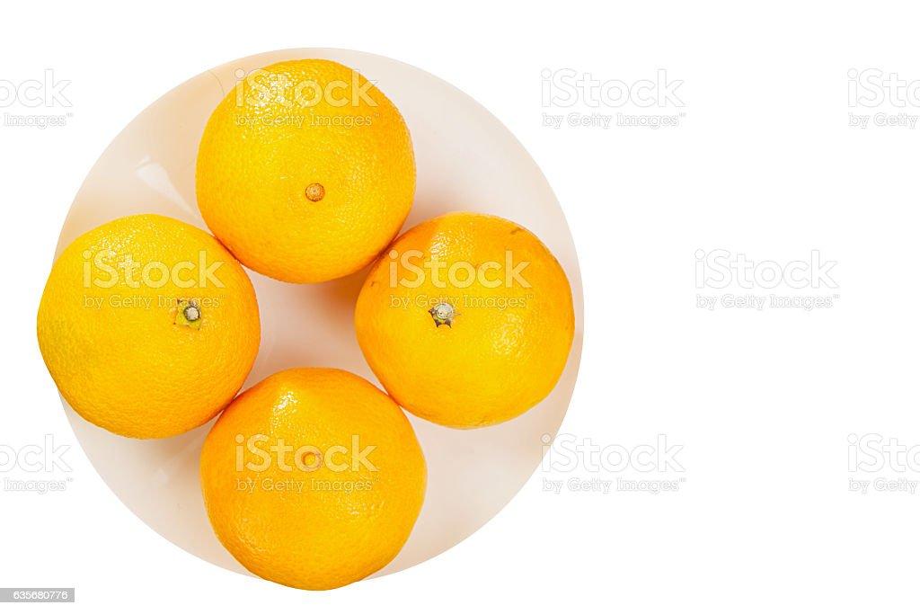 juicy Spanish mandarins on plate on white background stock photo