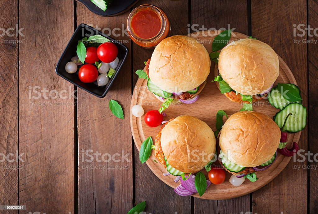Juicy spicy chicken burgers to Asian-style - sandwich stock photo