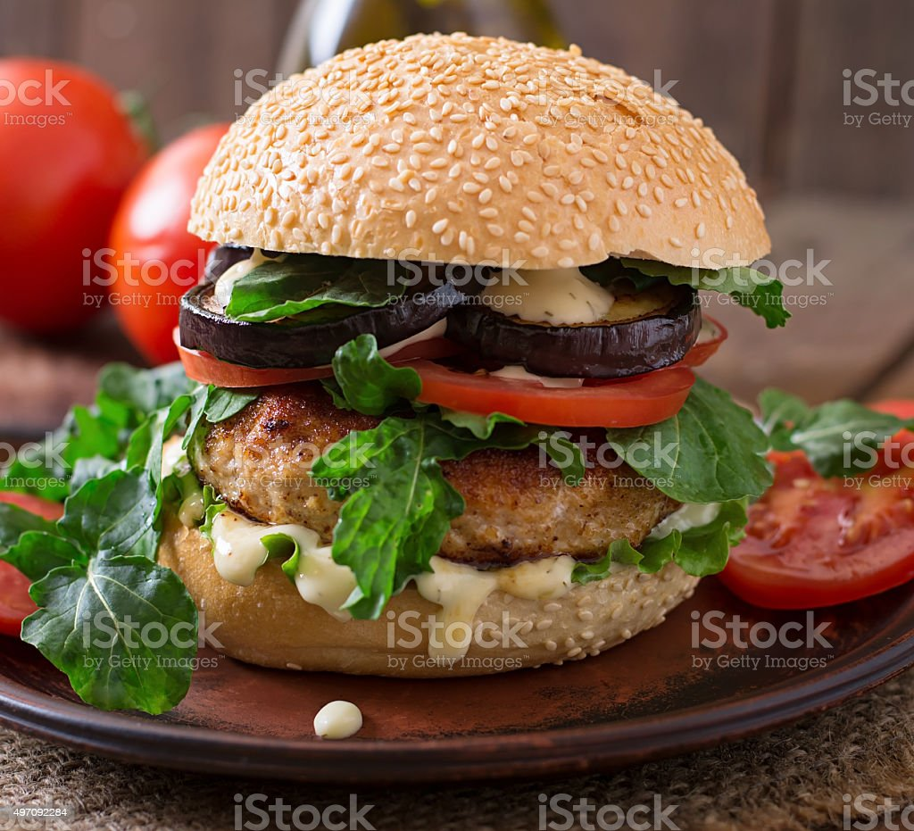 Juicy spicy chicken burgers with tomato and eggplant - sandwich. stock photo