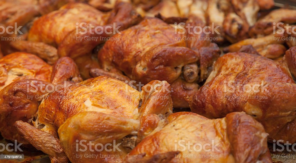 Juicy spit roasted chicken stock photo